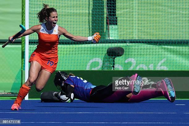 Ellen Hoog of Netherlands celebrates after scoring the game winning goal on goalie Kristina Reynolds of Germany in a sudden death shootout during the...