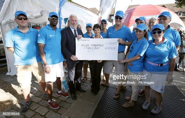 Ellen MacArthur receives a cheque from Sir Robin KnoxJohnston and the crew of OneDLL in St Katharine Docks London