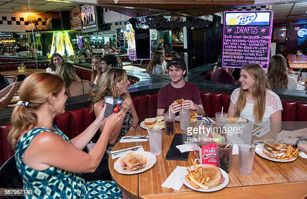Ellen Michelle Mat and Paige Filipink of Aurora IL having lunch Upstairs at Charlie's Kitchen in Harvard Sq Cambridge MA on August 21 2013 President...