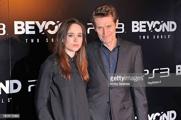 Ellen Page and Willem Dafoe attend the 'Beyond Two Souls' Paris Premiere at the Grand Rex on October 2 2013 in Paris France