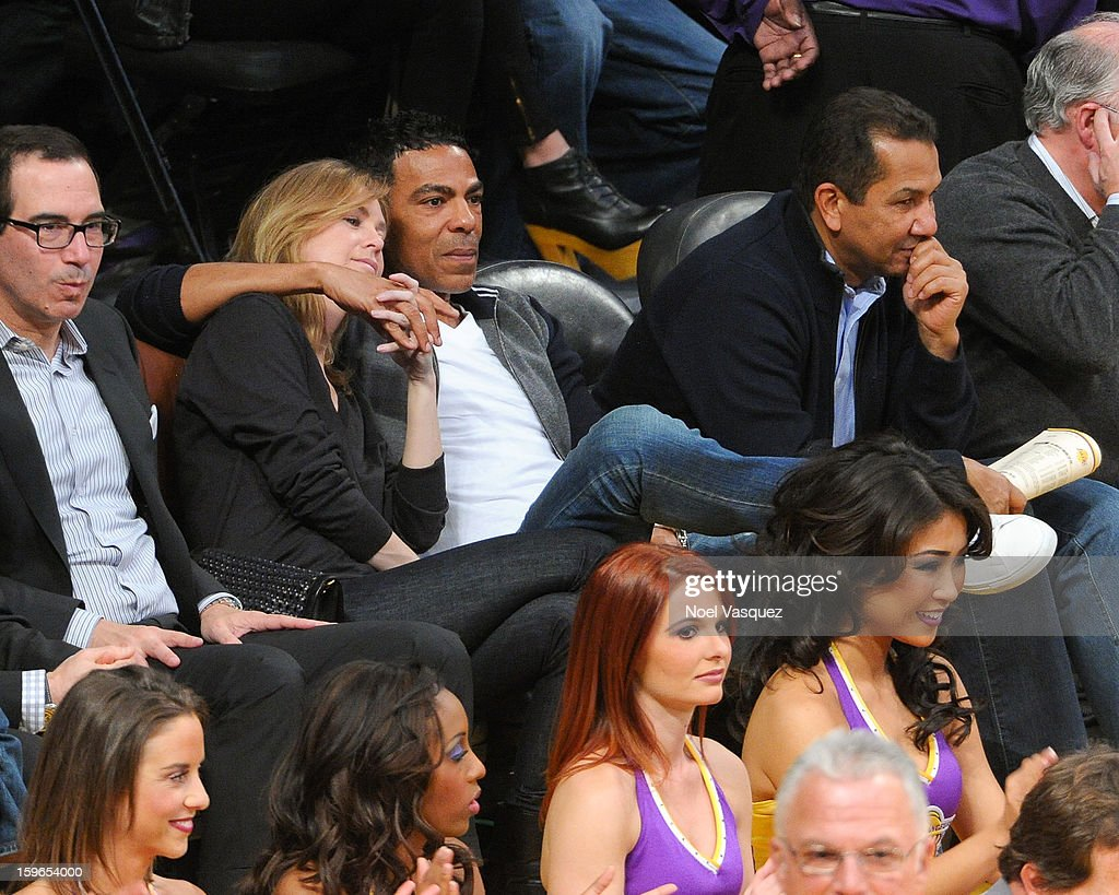 Ellen Pompeo (L) and Chris Ivery attend a basketball game between the Miami Heat and the Los Angeles Lakers at Staples Center on January 17, 2013 in Los Angeles, California.