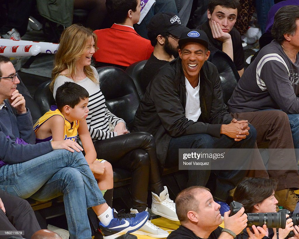 Ellen Pompeo (L) and Chris Ivery attend a basketball game between the Oklahoma City Thunder and the Los Angeles Lakers at Staples Center on January 27, 2013 in Los Angeles, California.
