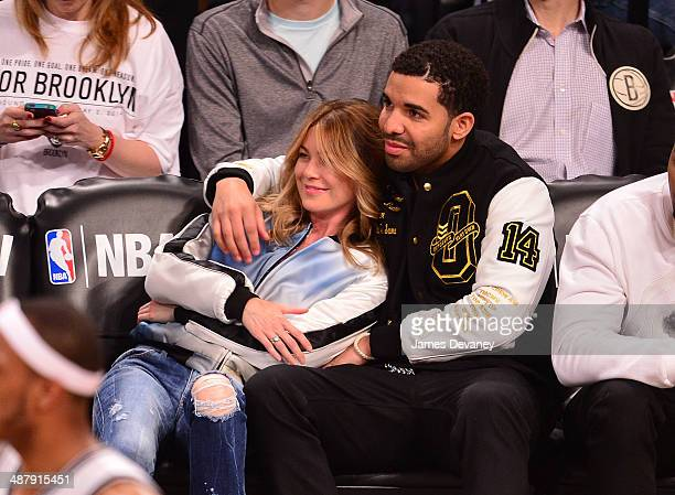 Ellen Pompeo and Drake attend the Toronto Raptors vs Brooklyn Nets game at Barclays Center on May 2 2014 in the Brooklyn borough of New York City
