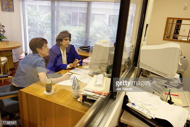 Ellen R Siegel from the Enrichment Group provides financial advice to Beth Barry July 17 2002 in Miami Florida With the current market volatility...