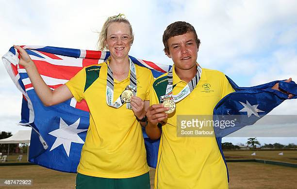 Ellen Ryan and Jonathon Davis of Australia pose with their gold medals after the medal presentation for the Mixed Pairs at the Lawn Bowls at the...
