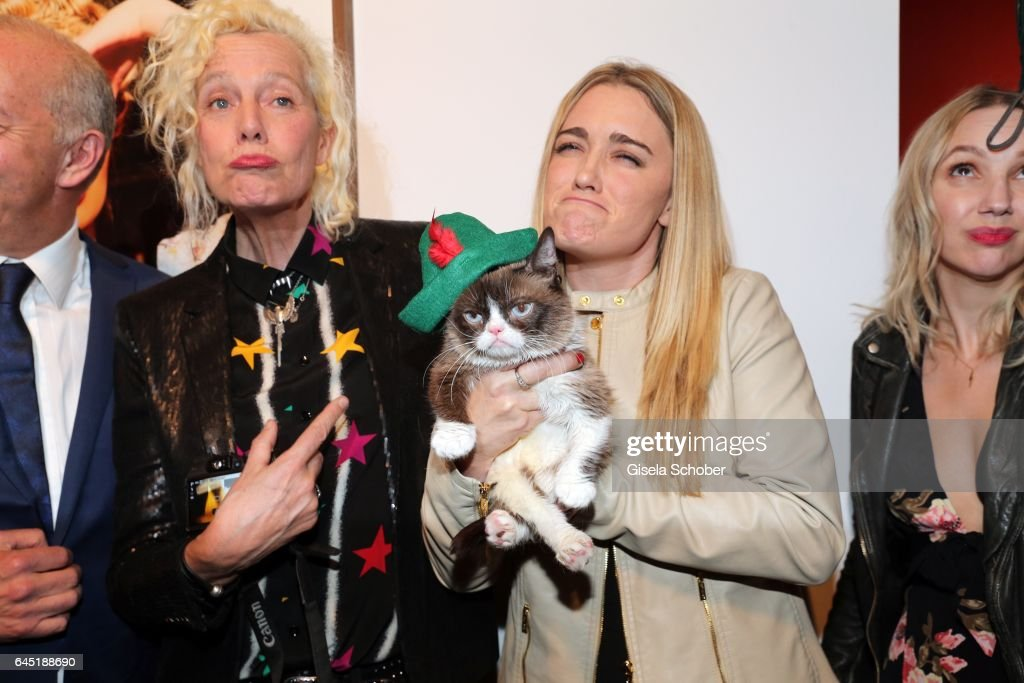 Ellen von Unwerth and Grumpy cat and her owner Tabatha Bundesen during the opening night of Ellen von Unwerth's photo exhibition at TASCHEN Gallery on February 24, 2017 in Los Angeles, California.