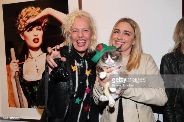 Ellen von Unwerth and Grumpy cat and her owner Tabatha Bundesen during the opening night of Ellen von Unwerth's photo exhibition at TASCHEN Gallery...
