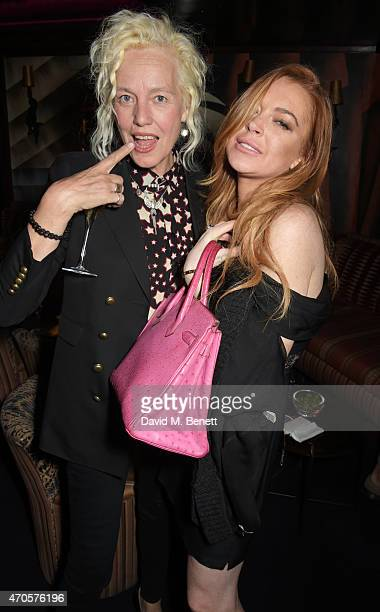 Ellen von Unwerth and Lindsay Lohan attend the DSQUARED2 dinner in celebration of their new London Flagship opening at Loulou's on April 21 2015 in...