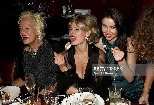 Ellen von Unwerth Gia Genevieve and Emma Miller attend the Hunger Magazine Vivienne Westwood Paris Fashion Week Event celebrating the Vivienne...