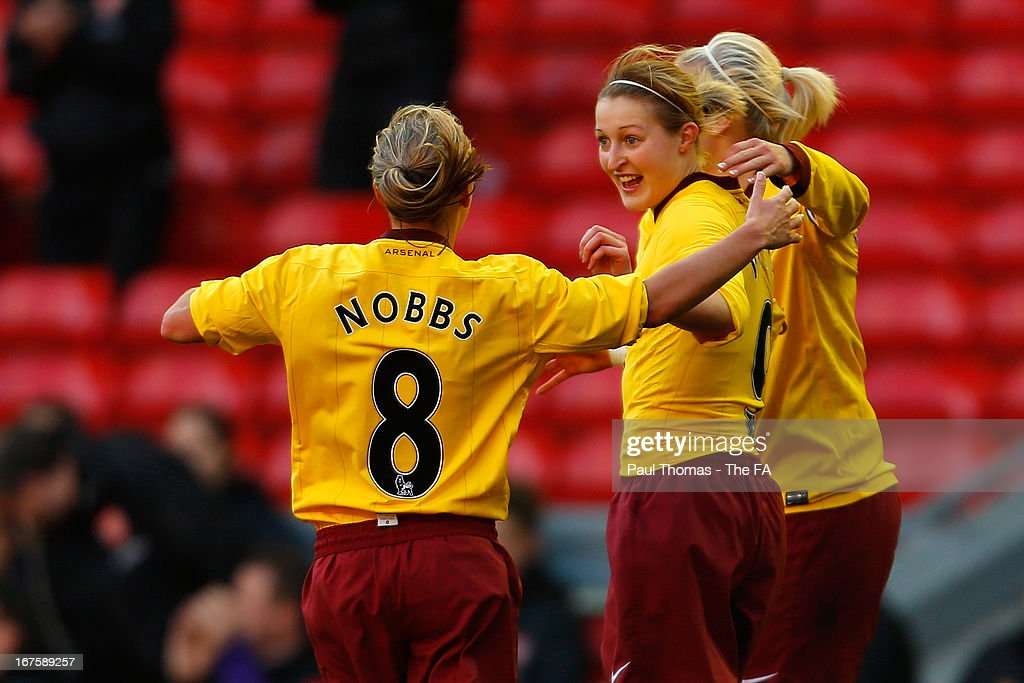 Ellen White (C) of Arsenal celebrates her goal with team mates Jordan Nobbs (L) and Stephanie Houghton during the Womens FA Cup Semi Final match between Liverpool Ladies FC and Arsenal Ladies FC at Anfield on April 26, 2013 in Liverpool, England.