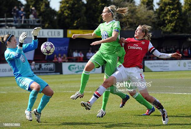 Ellen White of Arsenal Ladies FC challenges Lena Goessling of Wolfsburg as the ball runs through to keeper Alisa Vetterlein of Wolfsburg during the...
