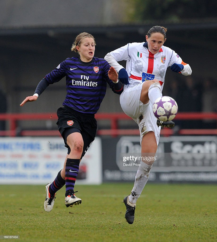 Ellen White (L) of Arsenal Ladies FC closes down Elisabetta Stracchi of Torres during the Women's Champions League Quarter Final match between Arsenal Ladies FC and ASD Torres CF at Meadow Park on March 20, 2013 in Borehamwood, United Kingdom.