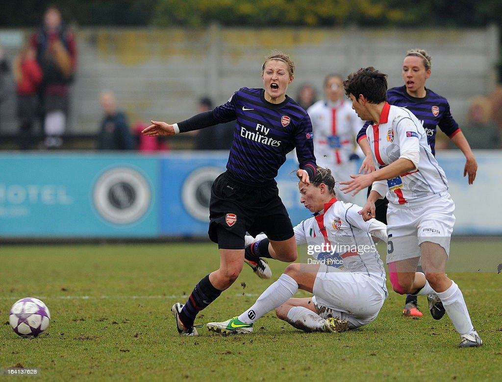 Ellen White of Arsenal Ladies FC is fouled by Sandy Maendly of Torres during the Women's Champions League Quarter Final match between Arsenal Ladies FC and ASD Torres CF at Meadow Park on March 20, 2013 in Borehamwood, United Kingdom.