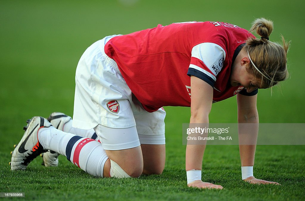 <a gi-track='captionPersonalityLinkClicked' href=/galleries/search?phrase=Ellen+White&family=editorial&specificpeople=4436830 ng-click='$event.stopPropagation()'>Ellen White</a> of Arsenal Ladies lies injured during the The FA WSL Continental Cup match between Lincoln Ladies and Arsenal Ladies at Sincil Bank Stadium on May 2, 2013 in Lincoln, England.