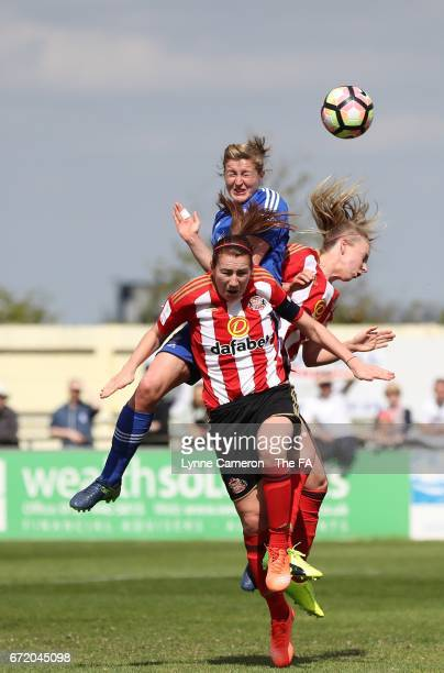 Ellen White of Birmingham City Ladies jumps with Stephanie Bannon and Hayley Sharp of Sunderland Ladies during the match between Birmingham City and...