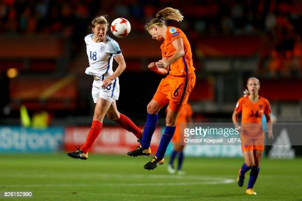 Ellen White of England and Anouk Dekker of the Netherlands go up for a header during the UEFA Women's Euro 2017 Second Semi Final match between...