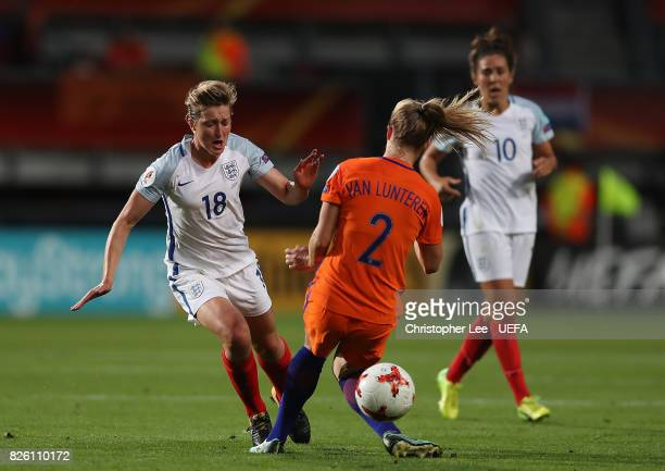 Ellen White of England and Desiree van Lunteren of The Netherlands battle for possession during the UEFA Women's Euro 2017 Semi Final match between...