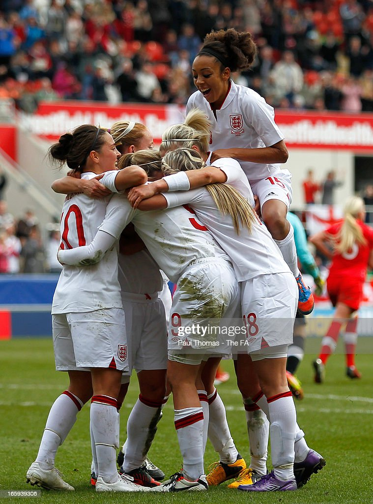 <a gi-track='captionPersonalityLinkClicked' href=/galleries/search?phrase=Ellen+White&family=editorial&specificpeople=4436830 ng-click='$event.stopPropagation()'>Ellen White</a> (C) of England celebrates her goal with team mates during the International friendly match between England and Canada at The New York Stadium on April 7, 2013 in Rotherham, England.