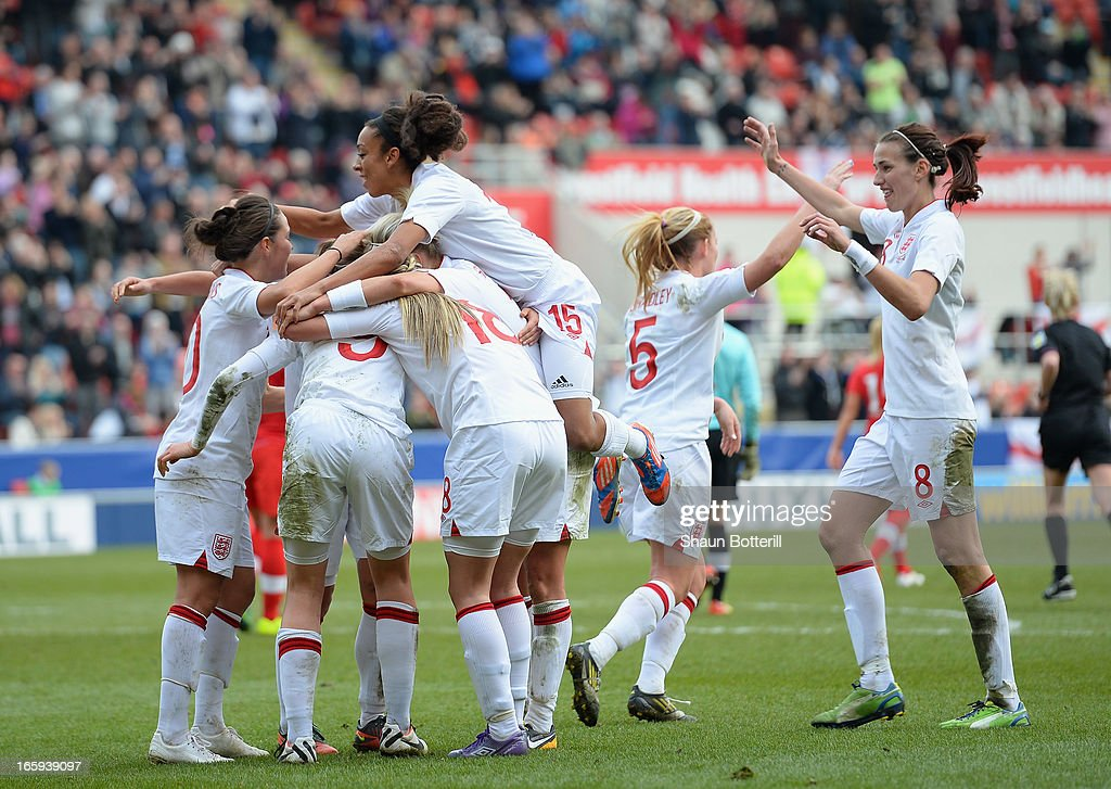 <a gi-track='captionPersonalityLinkClicked' href=/galleries/search?phrase=Ellen+White&family=editorial&specificpeople=4436830 ng-click='$event.stopPropagation()'>Ellen White</a> of England is congratulated by team-mates after scoring during the Women's International Match between England Women and Canada Women at The New York Stadium on April 7, 2013 in Rotherham, England.