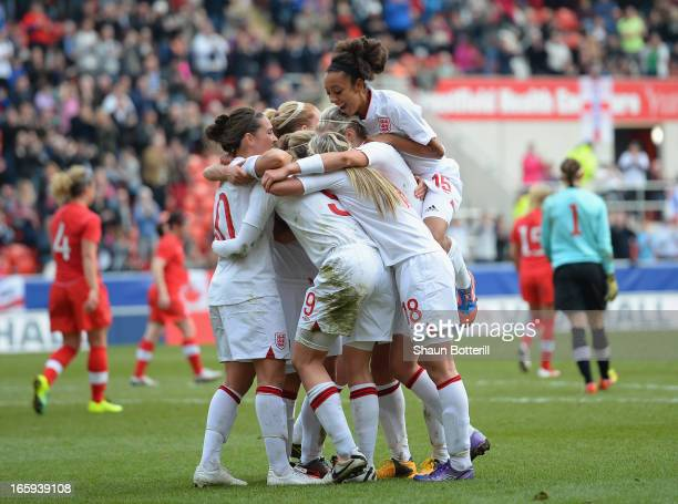Ellen White of England is congratulated by teammates after scoring during the Women's International Match between England Women and Canada Women at...