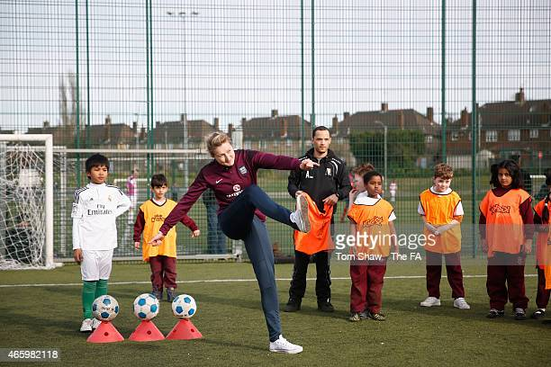 Ellen White of England plays a bit of football with local children at the FA Together for England Roadshow at The Hive on March 12 2015 in Barnet...
