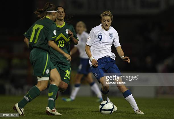 Ellen White of England runs at Urska Zganec of Slovenia during the England v Slovenia UEFA Women's Euro 2013 qualifying match at the County Ground on...