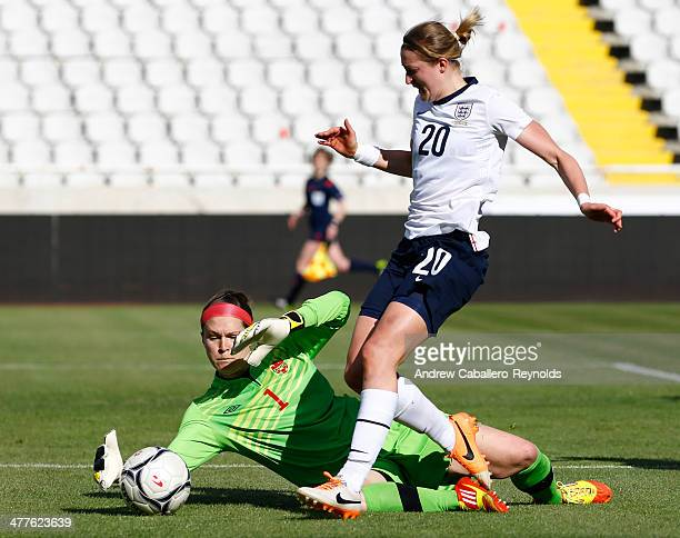 Ellen White of England tires to shoot past goalkeepr Erin McLeod of Canada during the Cyprus Cup match between England and Canada at GSP stadium on...