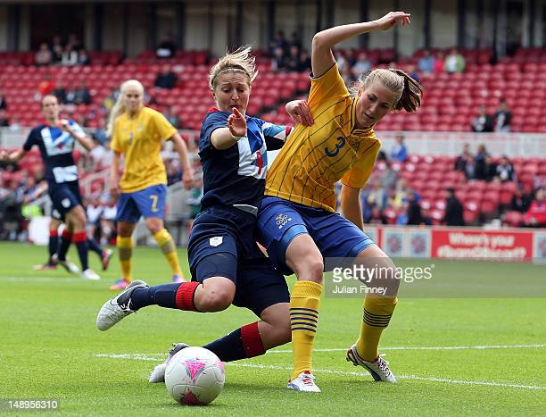 Ellen White of GB clashes with Emma Berglund of Sweden during the international friendly match between Team GB Women and Sweden Women at the...