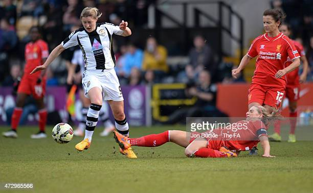 Ellen White of Notts County Ladies FC avoids the challenge of Gemma Bonner of Liverpool Ladies FC during the WSL match between Notts County Ladies...