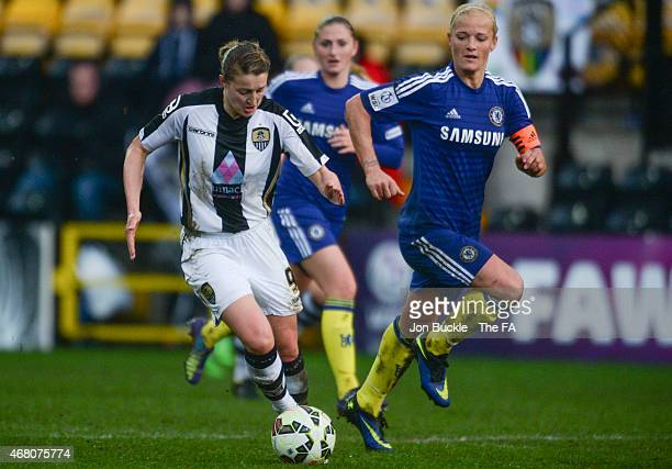 Ellen White of Notts County Ladies FC is challenged for the ball by Katie Chapman of Chelsea Ladies FC during the WSL match between Notts County...