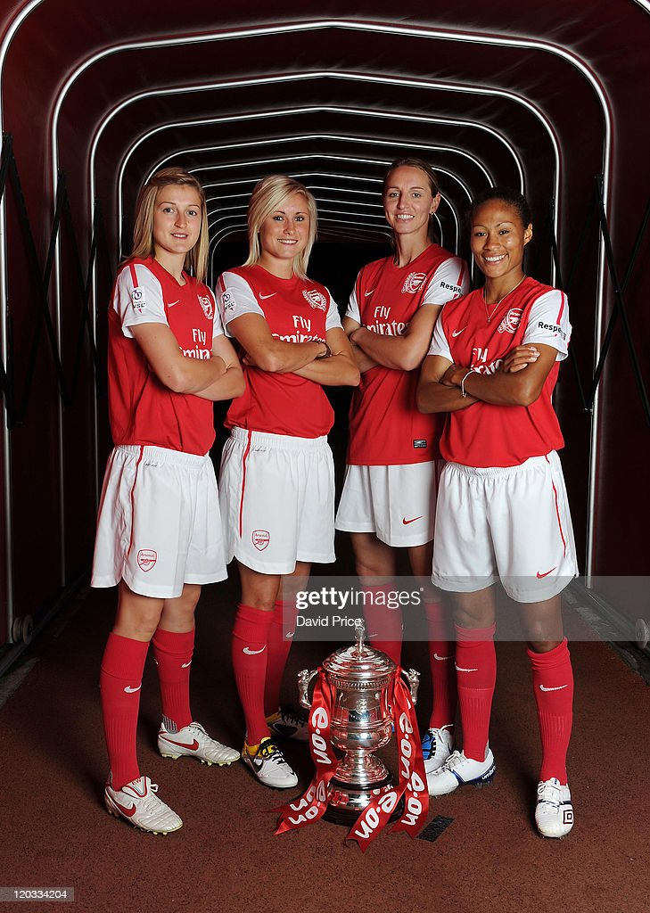 Ellen White, Steph Houghton, Faye White and Rachel Yankey of Arsenal Ladies pose with Women's FA Cup Trophy during the ladies team photocall at Emirates Stadium on August 4, 2011 in London, England.