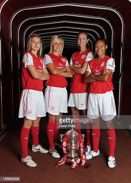 Ellen White Steph Houghton Faye White and Rachel Yankey of Arsenal Ladies pose with Women's FA Cup Trophy during the ladies team photocall at...