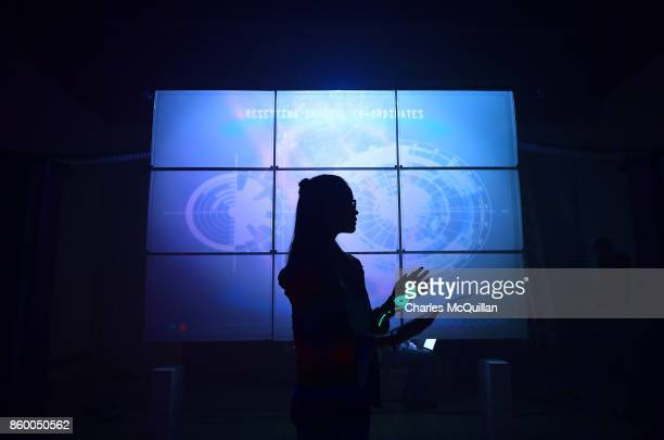 Ellen Whitehead who plays Minecraft Time Riders character 'Maddy' controls a time machine via a large projection screen during a 'Playcraft' live...
