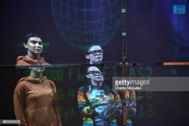 Ellen Whitehead who plays Minecraft Time Riders character 'Maddy' and Rhea Melvin who plays 'Sal' are reflected on a large stage screen as they...