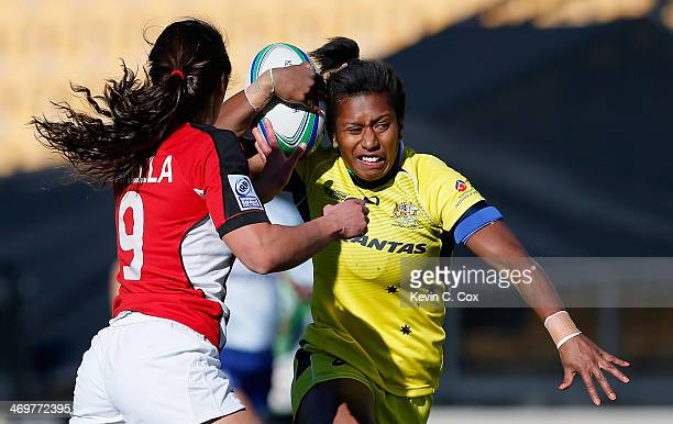 Ellia Green of Australia breaks a tackle by Bianca Farella of Canada during the Women's Sevens World Series at Fifth Third Bank Stadium on February...