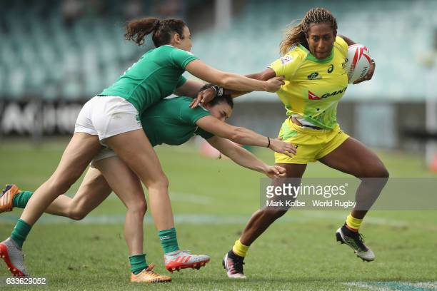 Ellia Green of Australia breaks away from the Ireland defender during the womens Pool B match between Australia and Ireland in the 2017 HSBC Sydney...