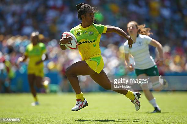 Ellia Green of Australia breaks away to score a try during the 2016 Sydney Sevens international friendly womens match three between Australia and...