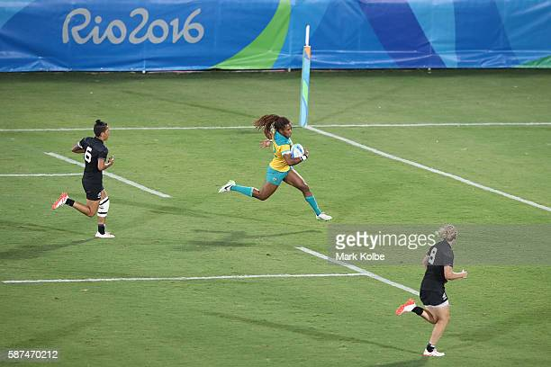 Ellia Green of Australia breaks away to score a try during the Women's Gold Medal Final Rugby Sevens match between Australia and New Zealand on...