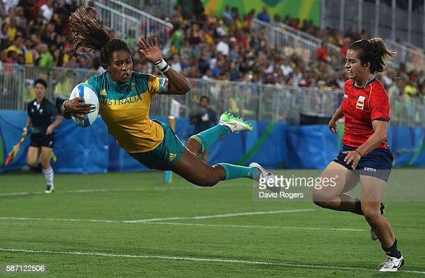 Ellia Green of Australia dives in to score a try against Patricia Garcia of Spain during the Women's Quarterfinal 1 rugby match on Day 2 of the Rio...
