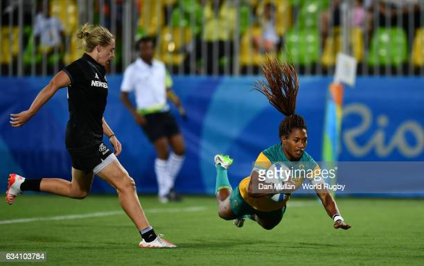 Ellia Green of Australia dives over for a try during the Women's Rugby Sevens Gold Medal match between Australia and New Zealand on day 3 of the Rio...