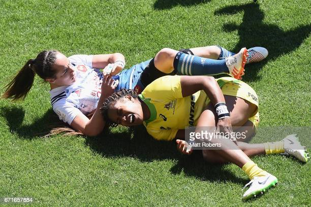Ellia Green of Australia grimaces after tackling Jade Le Pesq of France during the HSBC World Rugby Women's Sevens Series 2016/17 Kitakyushu quarter...