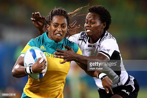 Ellia Green of Australia is tackled during a Women's Pool A rugby match between Australia and Fiji on Day 1 of the Rio 2016 Olympic Games at Deodoro...