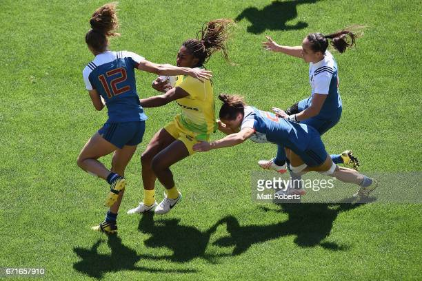 Ellia Green of Australia is tackled during the HSBC World Rugby Women's Sevens Series 2016/17 Kitakyushu quarter final between Australia and France...