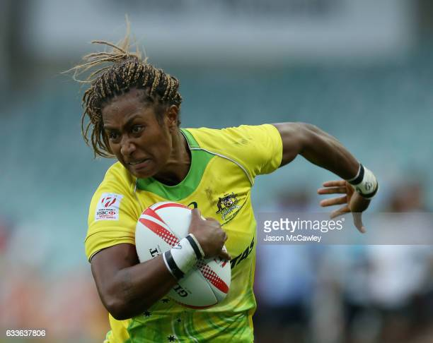 Ellia Green of Australia runs the ball during the pool match between Australia and Fiji in the 2017 HSBC Sydney Sevens at Allianz Stadium on February...