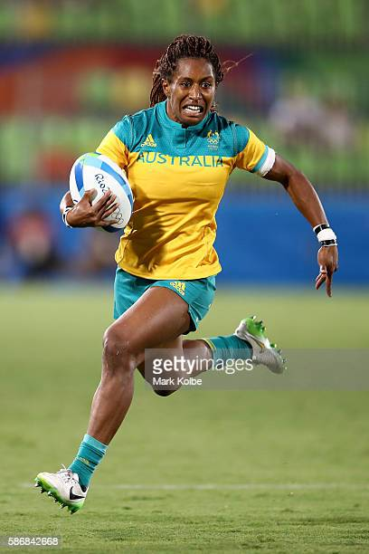 Ellia Green of Australia runs with the ball during a Women's Pool A rugby match between Australia and Fiji on Day 1 of the Rio 2016 Olympic Games at...