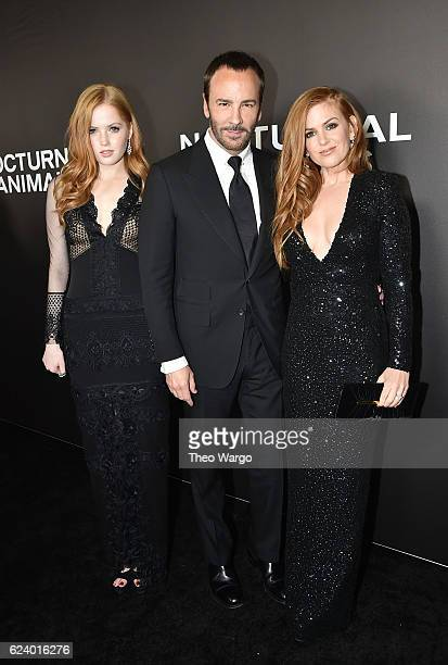 Ellie Bamber Director Tom Ford and Isla Fisher attend the 'Nocturnal Animals' premiere at The Paris Theatre on November 17 2016 in New York City