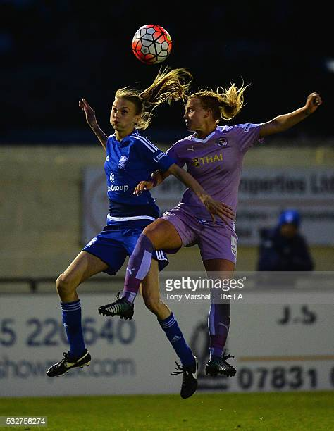 Ellie Brazil of Birmingham City Ladies is tackled by Molly Bartrip of Reading FC Women during the WSL 1 match between Birmingham City Ladies and...