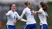 Ellie Brazil of England celebrates with team mates Laura Hooper and Niamh Charles after scoring the opening goal during the U17 girl's international...