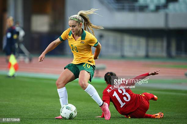 Ellie Carpenter of Australia and Hoang Thi Loan of Vietnam compete for the ball during the AFC Women's Olympic Final Qualification Round match...