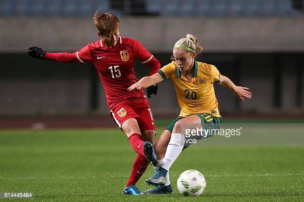 Ellie Carpenter of Australia and Lou Jiahui of China compete for the ball during the AFC Women's Olympic Final Qualification Round match between...
